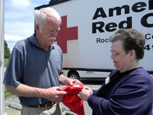 Veteran travels cross country to return Red Cross comfort bag