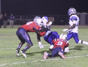 <p>Franklin Parish sophomores Damien Plater (4) and Gary Fletcher (2) bring down West Feliciana's Mack Johnson in week two.</p>