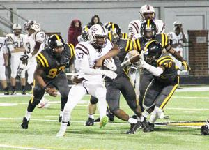 <p><strong>THE NEVILLE</strong> defense swarms a Breaux Bridge player last week in the Tigers' 56-30 victory. Neville will travel to Algiers to face Karr.</p>