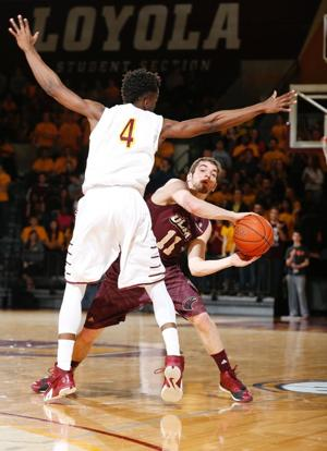 <p><span>ULM sophomore Nick Coppola (11) looks to pass the ball in </span>game one of the College Basketball Invitational (CBI) best of three championship on Monday. Loyola-Chicago topped ULM, 65-58. </p>