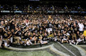 <p>Neville Tigers the 2014 LHSAA Class 4A State Champions celebrate with the Neville Nation's eleventh football state championship trophy</p>