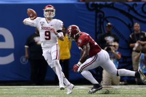 <p>Oklahoma quarterback Trevor Knight (9) passes the ball over Alabama  linebacker C.J. Mosley (32) in the second half of the 2013 Sugar Bowl at the Mercedes-Benz Superdome. Oklahoma defeated Alabama, 45-31.</p>