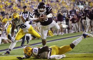 <p>Mississippi State QB Dak Prescott punches in a touchdown in the Bulldogs win over LSU on Saturday.</p>