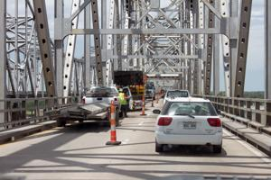 <p>TRAFFIC ON the westbound lanes of the Mississippi River Bridge at Natchez-Vidalia has been reduced to one-lane as preparations are being made for extensive repair work. The closing of alternating lanes will continue for several weeks, according to the Mississippi Department of Transportation. (Photo by Rhett Powell)</p><div> </div>