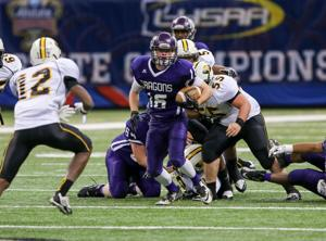 <p>Kyle Barefield (16) carries the football in the Class 1A State Title game.</p>