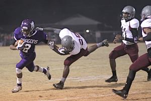 <p>Mangham running back Jakarie Nichols (2) breaks free of a White Castle defender last year during the 1A playoffs.</p>