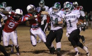 <p>Christian Wallis (1) picks up a first down in South Terrebonne's regional round win over Franklin Parish on Friday. Wallis led the Gators with 27 carries for 186 yards on two touchdowns.</p>