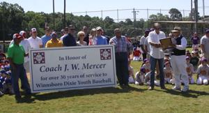 <p><span>Mayor Jackie Johnson presents coach J.W. Mercer with the keys to the City of Winnsboro. Mercer was honored by Dixie Youth Baseball for his 30 years of service.</span></p>