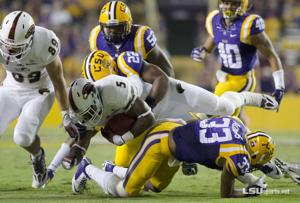 <p>ULM running back Centarius Donald (#5) is stuffed by the LSU defense after a short gain in the ULM at LSU game at LSU's Tiger Stadium on Saturday, September 13.  LSU won the game 31-0 over the visiting Warhawks.</p>