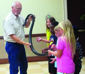 <p><strong>Terry Vandeventer</strong>, herpetologist, shares his knowledge of snakes with young readers at the Ferriday Library. This event was co-sponsored by Concordia Bank & Trust, Company.</p>