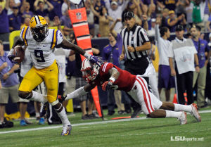 <p>Neville alumnus John Diarse (#9) on his way to a 36-yard touchdown to cut into the Wisconsin lead 21-19 with 12:08 remaining in the game. On the ensuing two point conversion, LSU sophomore quarterback Anthony Jennings hooked up with Trey Quinn to tie the game at 21-21. LSU went on to win the game 28-24 in the AdvoCareTexas Kickoff Classic at Houston'sNRG Stadium on Saturday, August 30.</p>