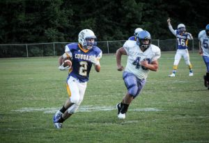 <p>Aaron Stewart (2) carries the ball for Franklin Academy during the Cougars' 36-6 win over Bethel Christian on Friday. Stewart carried the ball 15 times for 187 yards in the seasoning-opening win for FA.</p>