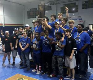 <p><strong>THE STERLINGTON</strong> boys powerlifting team celebrates after winning the Division IV state championship.</p>