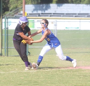 <p>Franklin Academy's Grace Johnson tags a Prairie View runner at third base during the PVA Tournament.</p>