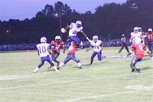 <p>West Feliciana's Jazz Ferguson (2) attempts to jump Franklin Parish defensive back Chris Williams (18) in the Saints' 21-0 win over the Patriots.</p>