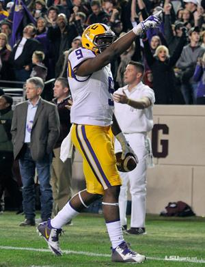 <p>Neville alumnus and LSU wide receiver John Diarse (#9) scores a 10-yard second quarter touchdown..</p>