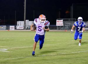 <p>Delhi Charter running back Christian Colvin (5) rushed for 154 yards and two scores on 32 carries to lead the Gators to a 29-12 victory over Vidalia.</p>
