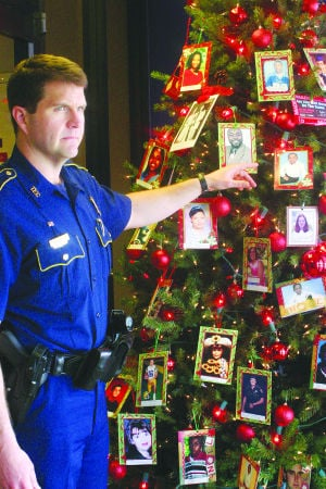 <p><strong>STATE TROOPER</strong> Albert Paxton talks about the memorial tree on display at Troop F headquarters in Monroe. The tree memorializes victims of drunk driving. (Citizen photo by Zach Parker)</p>