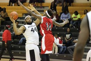 <p>Neville junior Rashad Lawrence (44) plays keep away with Franklin Parish senior Greg Atkins (14) on Tuesday. </p>