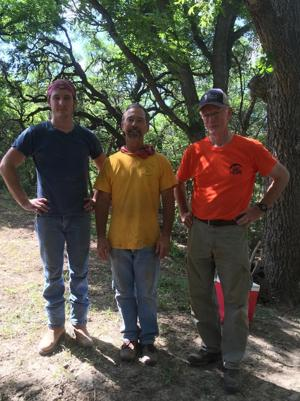 <p>Ben Shields, left, along with his father, Clare Shields and Kenneth Young (right) stand on property located along the banks of the Blanco River in Texas, where they volunteered with Hope Reigns to help with recovery efforts following flooding which took place in May. </p>