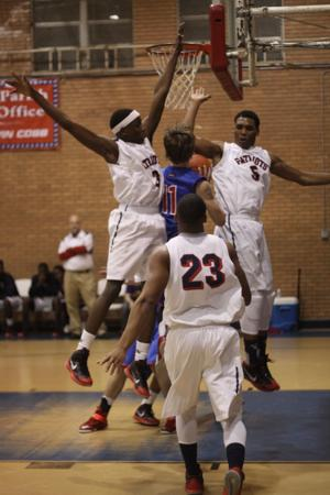 <p>Franklin Parish defenders swarm a West Ouachita player in district play earlier this season.</p>