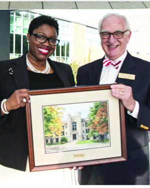 <p>Allison A. Thomas, left, is presented the 2014 Distinguished Alumni Award from the University of Arkansas - Dale Bumpers College of Agricultural Food and Life Sciences. Making the presentation is Dr. Steve Halbrook, head of the Department of Agriculture and Economics. (Submitted photo)</p>