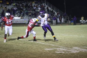 <p>Franklin Parish DB Chris Williams (18) tackles Wossman QB Cameron Lewis. </p>