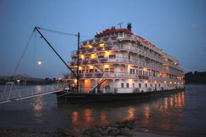 <p><strong>A FULL</strong> moon shines on the Mississippi River as members of the crew on the Queen of the Mississippi gather on the deck on the Concordia Parish shore. The riverboat makes regular stops at Vidalia. (Photo by Rhett Powell)</p>
