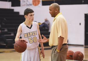 <p>Austin Herpak, who has autism, talks with Mapletown's head basketball coach Rick Hill before the start of recent game against Geibel Catholic.</p>