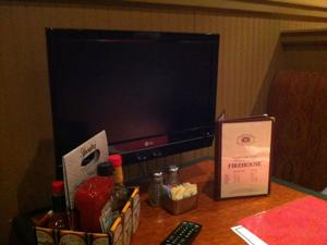 Pechin's Firehouse Restaurant - Booth flat screen TV