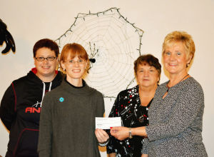 Eagles Auxiliary presents check to Domestic Violence Services