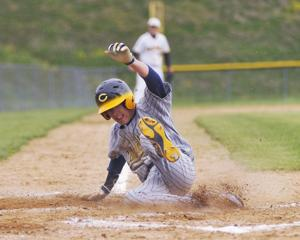 <p>Carmichaels' Darren Krause slides into home to score a run during the Mikes' Section 1-A win over Bentworth Friday at Bentworth.</p>