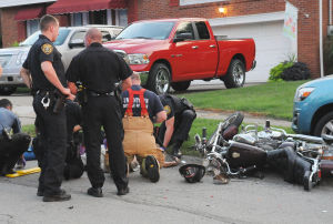 Motorcycle and car collide on Unon Street