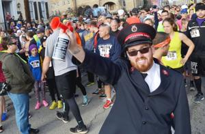 <p>Lori C. Padilla</p><p>The Salvation Army Turkey Trot 5K had the weather on it's side Thursday morning as temperatures were in the 40's without the snow of last year. Lt. Larry Fulmer, pastor and commanding officer of the Uniontown Salvation Army, prepared to signal the beginning of the race by sounding the air horn. See story and column on B1.</p>