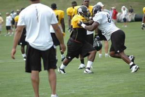 Ivy, McCoy get physical at training camp