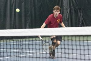 <p>Holly Tonini</p><p>California's John Monroe keeps the ball in play against Highlands' Eric Huett in their No. 1 singles match during the opening round of the WPIAL Class AA Team Tennis Championships Wednesday played at the Greensburg Racket Club.</p>