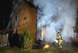 Firemen battle house fire in Uniontown