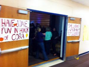 Signs outside the gym for Cora Rugland's memorial service urged smiles