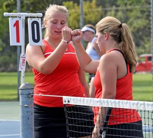 meet poynette singles 2010-11-13 poynette's alisha saley reacts after teammate samantha reigel's third straight service ace lifted the pumas to a  portage's abi boeck watches as she sets to make a return during a no 3 singles match of a dual meet with.