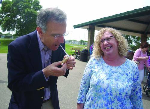 County Executive Parisi has a s'more in Waunakee