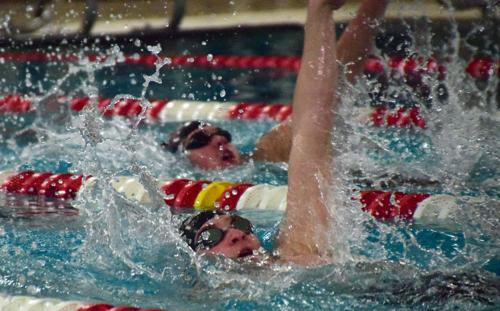 Boys Swimming: Home invite champs