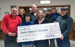 Snowmobile club donation