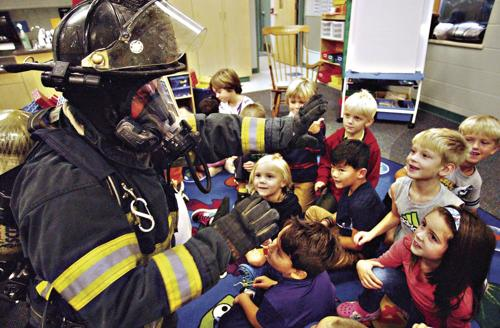 Kids greet firefighters during prevention week