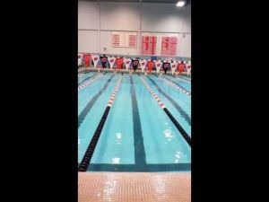 Spartans' Heiser competes in the 100 backstroke