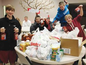 TRINITY YOUTH COLLECT 1,084 POUNDS OF FOOD