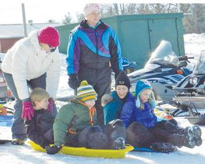 Family gets ready to sled