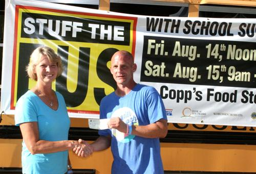 Sun Prairie Lions donate to Stuff the Bus