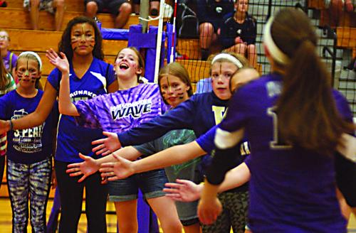 Fans of Volleyball enjoy youth night