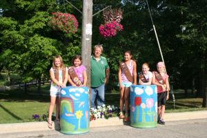 Girl Scouts donate rain barrels