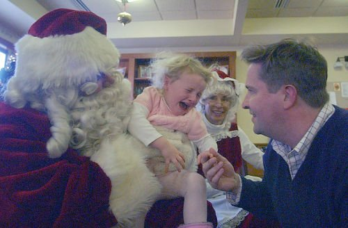 Santa visits with families at Village Center on Dec. 7